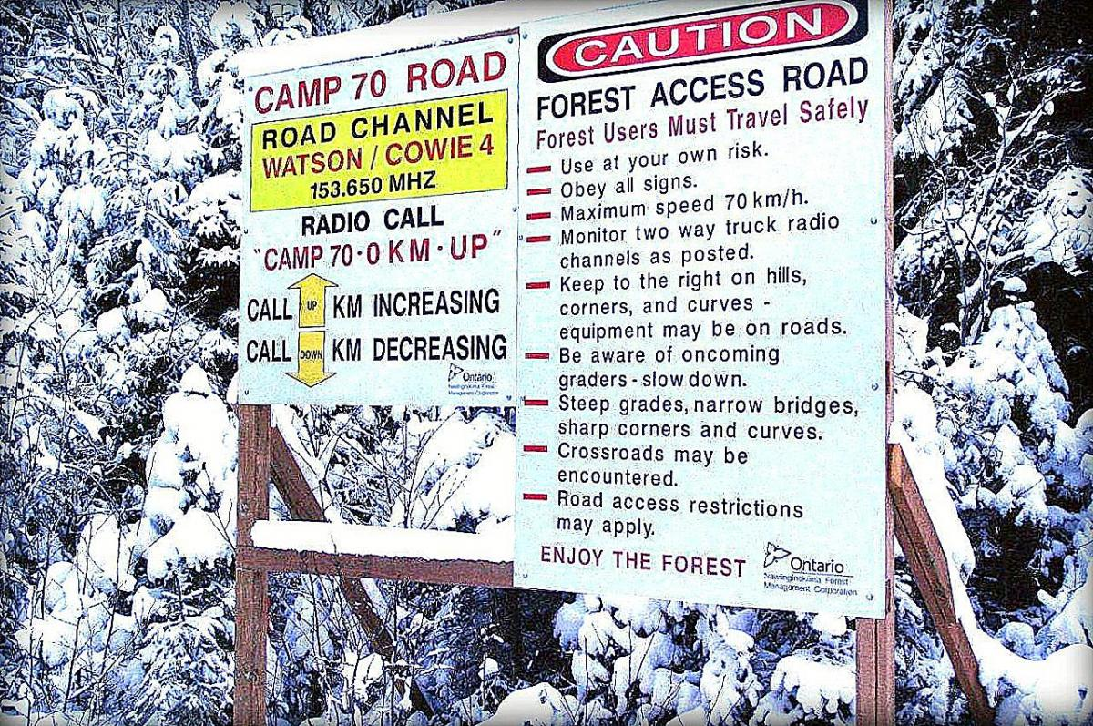 Forest access road signs with radio channel protocol and public warning