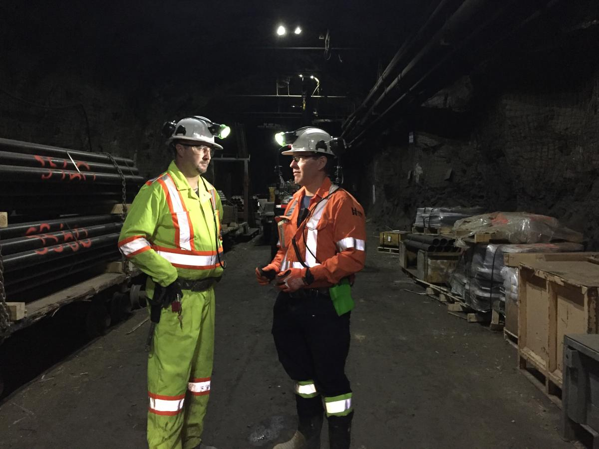 Two miners talking underground