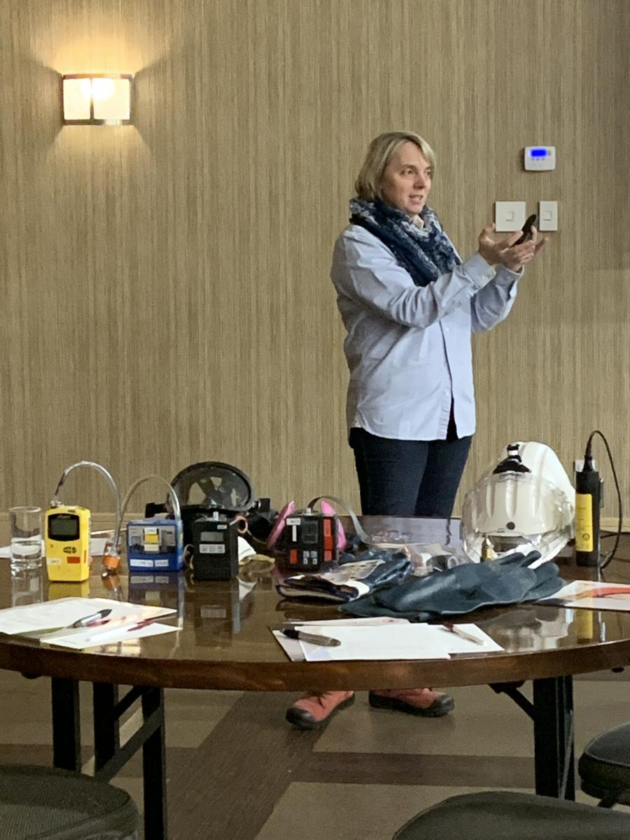 Woman demonstrating industrial hygiene devices