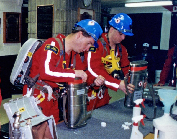 Two mine rescue volunteers checking equipment during competition