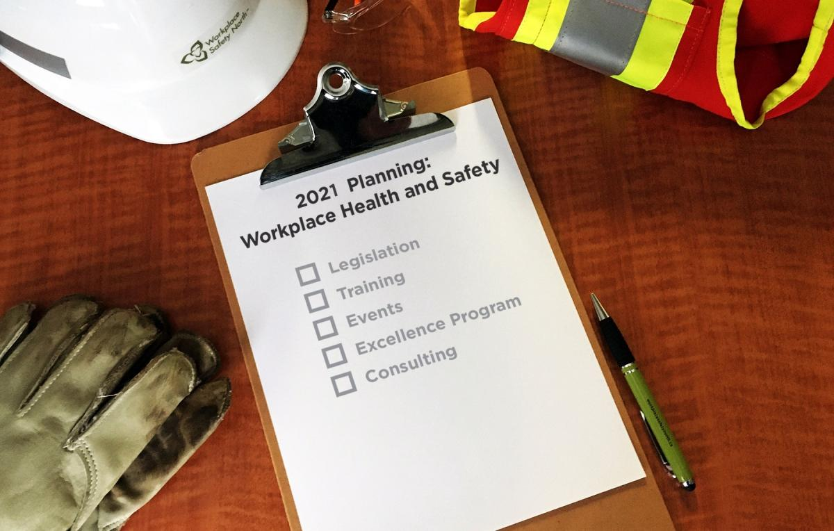 Clipboard, hardhat, gloves and safety vest